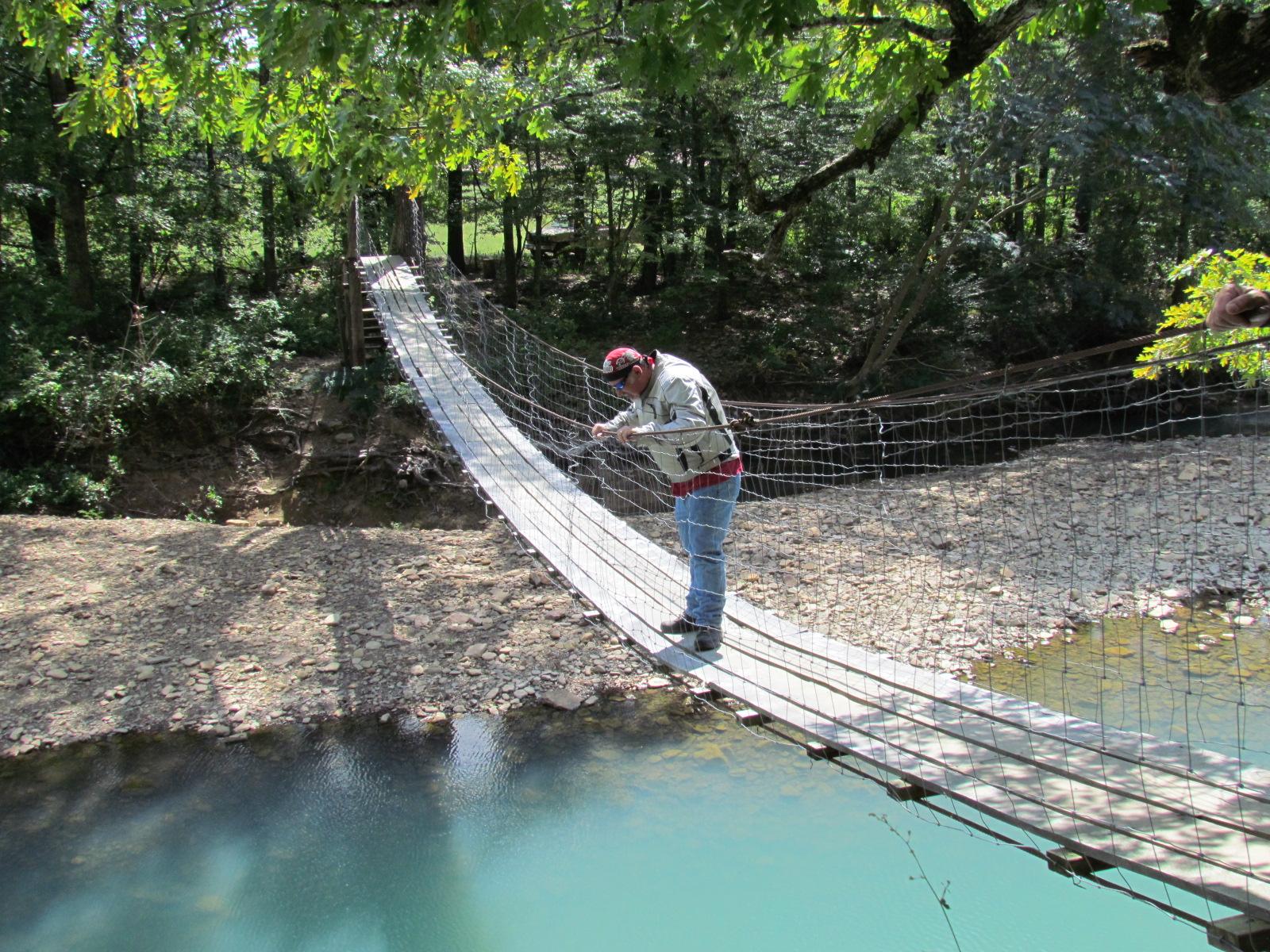 Swinging bridge fish house