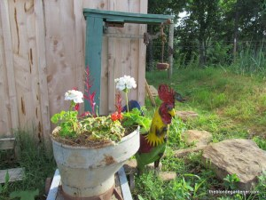 garden art  at the chicken coop  https://theblondegardener.com/2015/08/01/chicken-coop-with-living-roof/