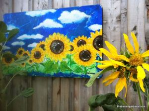 sunflower painting on the chicken coop  https://theblondegardener.com/2015/08/01/chicken-coop-with-living-roof/