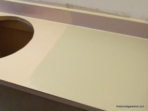 Using countertop paint to cover old formica '70's lake house remodel  https://theblondegardener.com/2015/03/08/70s-lake-house-remodel/