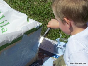 painting our bee box  http://theblondegardener.com/2015/05/09/bee-update/