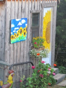chicken coop front door  https://theblondegardener.com/2015/08/01/chicken-coop-with-living-roof/